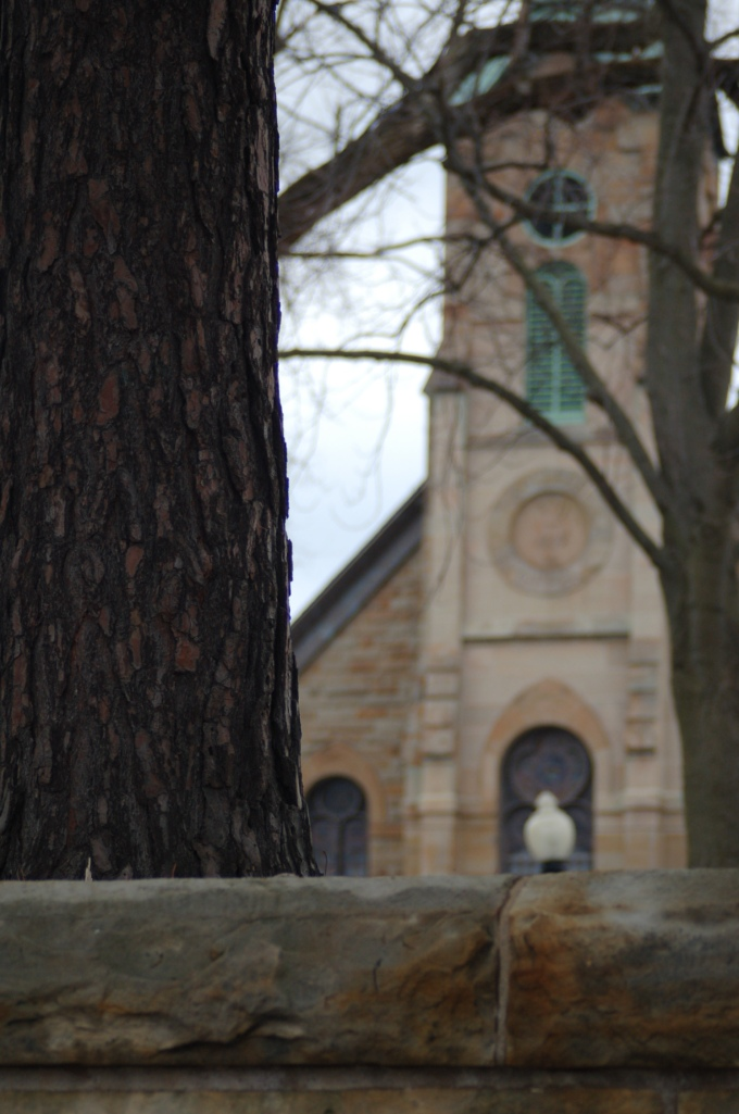 And a pretty church behind a stone wall and tree.